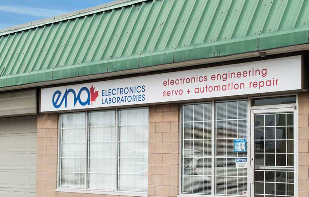 outside of a shop door front with the ena electronics logo across the top banner