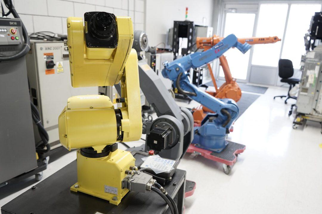 lineup of multi colour robotic machines in a laboratory